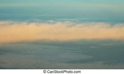 View from airplane of morning clouds