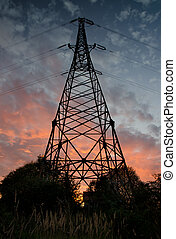 Power Line With Cell Tower At Sunset - high voltage...