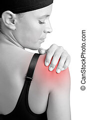 Shoulder Pain - Young woman with pain in her shoulder
