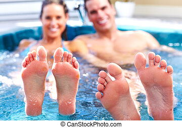 Young couple in jacuzzi - Young relaxed couple in jacuzzi...