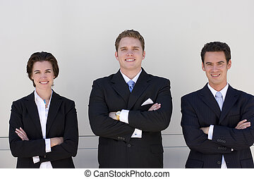 business team - three business people standing in a row...