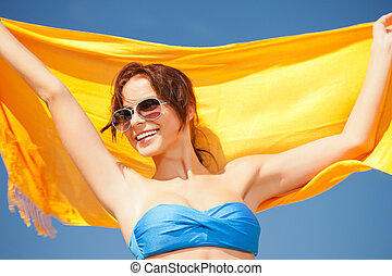 happy woman with yellow sarong on the beach - picture of...