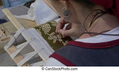 Female embroider - Moscow, Russia - July, 7, 2012: Moscow...