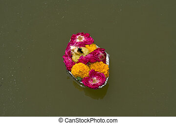 Floating Tray of Flowers - Offering of flowers left floating...