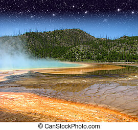 Landscape and Geysers of Yellowstone National Park at Night...