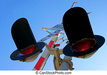 Rail Cro - Railroad Crossing signal from below with sky in...