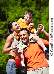 Loving family - Portrait of sporty family having good time...