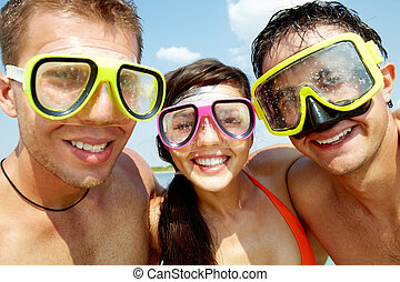 Scuba friends - Portrait of three cheerful friends wearing...