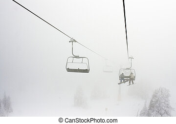 Ski Resort Chairlift in Fog - High altitude alpine...