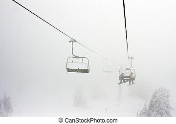 Ski Resort Chairlift in Fog - High altitude alpine...