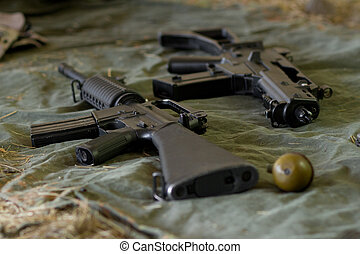 Arsenal of guns lying on the ground - Automatic guns and...