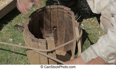 Man making barrell - Two workers are making a barrell in a...