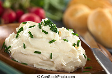Fresh Cream Cheese - Fresh cream cheese spread on wooden...