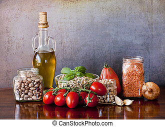 Legumes and vegetables on the kitchen table - a great...