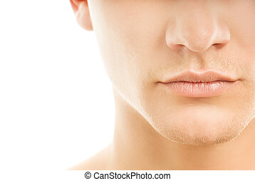 Close-up shot of a part of mans face Isolated on white...