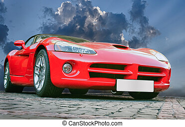 sports car - red sports powerful car on stone blocks against...