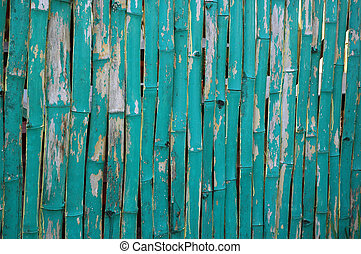 pattern of faded green bamboo fence
