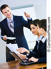 Business report - Image of successful man giving a report at...