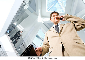 Busy man - Image of busy successful man in suit in the...
