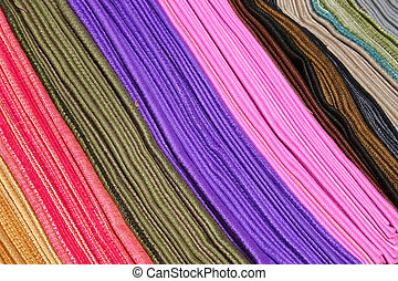 Rows of Colored Scarves - Rows of colored scarves at the...