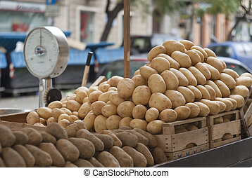 pile of new and old potatoes for sale
