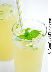 Fresh lemonade in glass with mint leaf