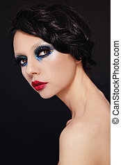 Make-up - Young beautiful woman with fancy make-up and...