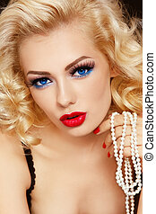 Blonde with pearls - Young beautiful woman with blond curly...