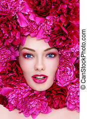 Woman in flowers - Portrait of young beautiful excited...
