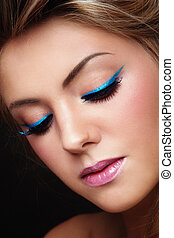 Blue eyeliner - Close-up portrait of young beautiful girl...