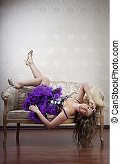 Beautiful girl on a luxurious couch - Image of a beautiful...
