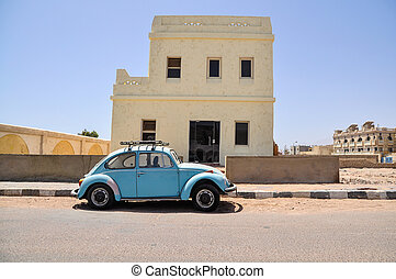 Classic Volkswagen Beetle car in the street of Egyptian town
