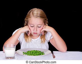 Child or teenager dislikes peas or vegtables, isolated on...