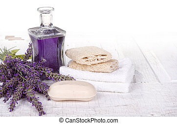 Lavender spa still life with soap, towels, and loofah