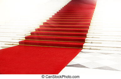 Staircase with red carpet, illuminated by light - Image on...