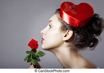 Glamorous girl in an elegant hat in the form of heart - The...