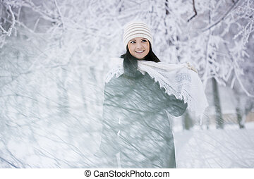 Beautiful girl in winter forest - The image of a beautiful...