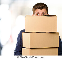Man holding cardboard boxes, outdoor