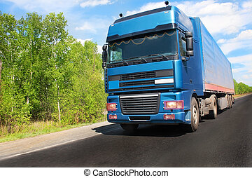 Trailer on country road - Trailer carrying cargo on country...