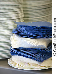 Napkins - Dark blue both white napkins and pile of plates