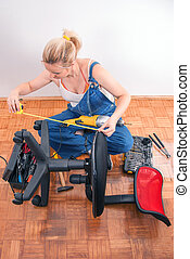 Home repairs - chair repair - Young girl prepairs to repair...