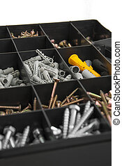 Home repairs kit - Close up of black plastik box with screws...