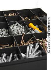 Home repairs kit - Close up of black plastik box with screws...