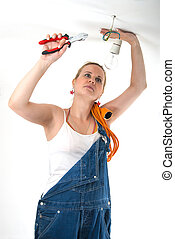 Home repairs - Electrician - Beautiful young girl fixing...