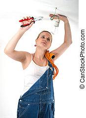 Home repairs - Electrician - Beautiful young girl fixing...
