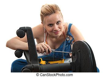 Home repairs - chair repair screwdriving - Young girl...