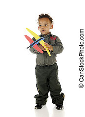 Tiny Airforce Pilot - An adorable preschooler holding a toy...