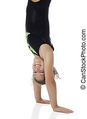 Happy Handstander - A happy elementary girl doing a...