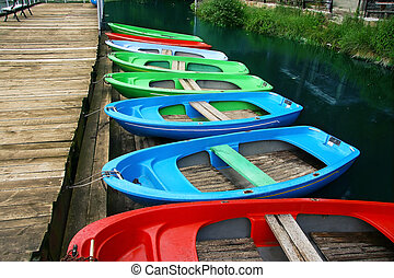 Colour boats at landing stage ashore