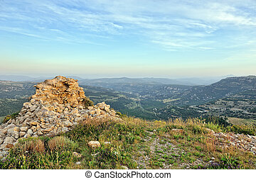 Rural landscape of the stony ruins with mountains view. Ares in Spain.